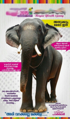 A hoarding depicting fanatic devotion to the elephant in the picture; the words on the left of the image in strong words portray their hatred towards yet another elephant.